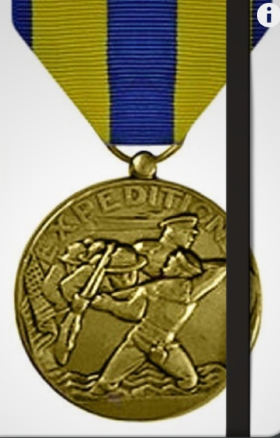 Photo of US Navy Expeditionary Medal on a notebook cover